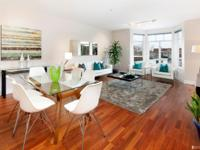 This beautifully designed 2 bed 1 bath condo is located