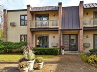 Sought after, bright 1st floor end unit home with