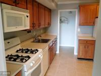 Spacious top level remodeled 2 bedroom 1 bath condo in