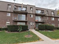 Desirable top floor 2 bedroom end unit that has been