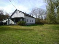 This pleasant home has a .76 acre large, level yard for