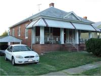 All brick large 2 bedroom and a full bath with a living
