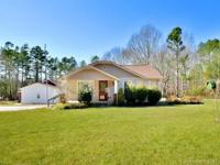 Clean and cozy home nestled on over 3 acres offers