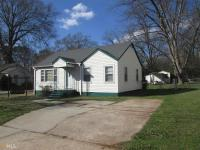 2 bedroom-1 bath home! Vinyl siding, wood deck, chain
