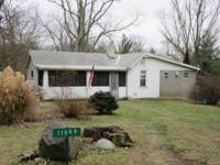 13.71 acres, beautiful home site. Small home on