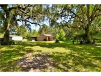A florida paradise on 9 + acres with 325.6' frontage on
