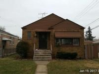 Bank-owned brick ranch with full basement and 2-car