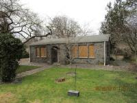 Needs roof, siding repair, incomplete bath remodel,