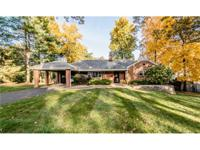 Stunning brick ranch with welcoming front porch! Single