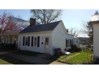 Good rental income or fixer-upper! Located in town,