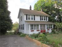 Classy cape cod/arts and crafts crossover style home,