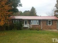 Nice brick home just minutes from city limits would be