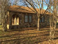 Rock home built in 1926 has 3.965 acres. Ok for animals