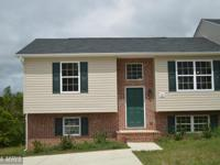 This Split Foyer has 2 bedrooms and 1 full bath with