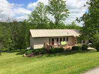Beautiful 2 Bedroom, 1.5 Bath on 1.4 ACRES! Wrap Around