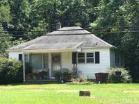 Charming 2 Bedroom home on 1 acre located just outside