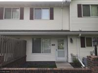 Nicely maintained townhouse on street level, this side