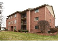 Appealing 3rd floor condominium with vaulted ceilings