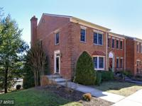 Beautifully maintained brick 3 level end townhome
