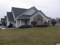 Carefree Living! Cluster home with 2BR/2BA, screened