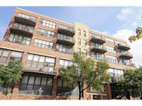 Sun-drenched corner unit two bedroom-two bath condo, in