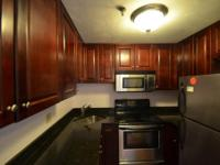 Large back facing 2 bed 2 bath condo unit. Granite and