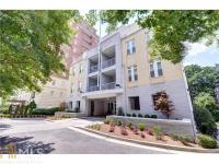 Sun-filled, top floor, corner unit with treetop and