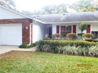 Welcome home to Winter Park 5192 Lazy Oaks Drive is a