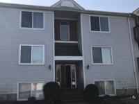 3rd floor unit w/vaulted ceilings & Fireplace. 2 bed, 2