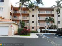 Desirable 1st Floor condo in Coral Lakes. Ultra clean,