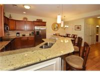 Must see this Gorgeous 1st floor condo! Features