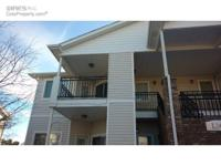 Charming upper floor condo featuring 2 bedrooms and 2