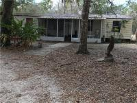 This five acre property is on a corner lot and has lots
