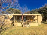 A rare find! This very well-kept manufactured home on a