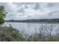 Lake front & very peaceful/private setting in this