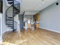 Modern townhouse with newly renovated windows, stucco,