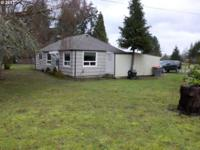 A super cute 1920's bungalow on a .96 acre lot with