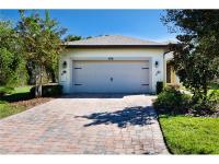 Solivita! This pristine Siesta Key Model is situated on