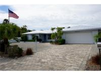 This fabulous wide canal/lagoon front home is located