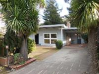 Absolutely charming mid century home. Light & airy with