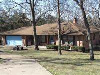 This full brick family home on 2 acres features 2 wood