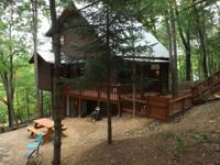 Enjoy mountain views and wooded privacy and priced well