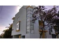 One of a kind corner unit just steps from the ocean,