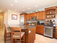 Beautiful condo features chefs kitchen with stainless