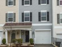 Immaculate 3 level, 1 car garage townhouse living in