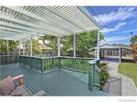 Tropical gardens and a koi pond welcome you home to