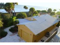 Fabulous and cozy 2BR/2BA Gulf front home directly