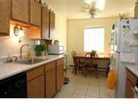 Upgraded units with oak cabinets and ceramic tile,