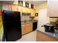All Wood Maple Cabinets in Kitchen and Bathroom,