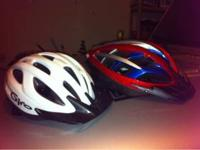 One adult BELL and one youth GIRO bicycle helmet for